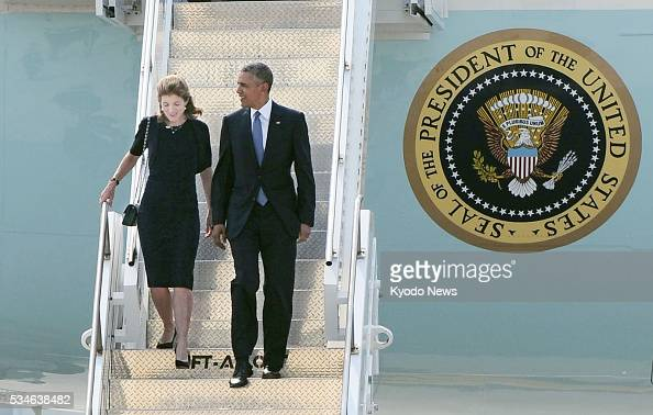 US President Barack Obama and US Ambassador to Japan Caroline Kennedy arrive at the Marine Corps' Air Station Iwakuni in the western Japanese city on...