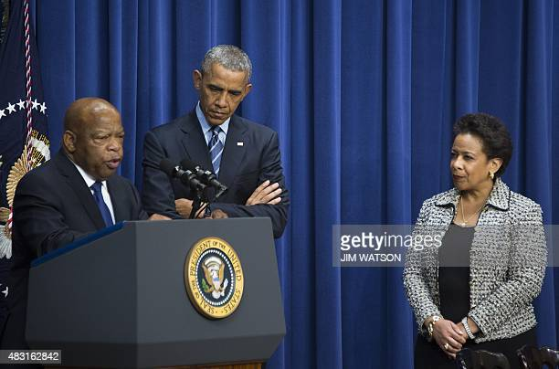 US President Barack Obama and US Attorney General Loretta Lynch listen as US Congressman John Lewis DGeorgia delivers remarks marking the 50th...