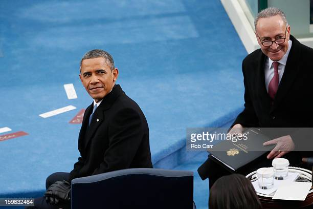 S President Barack Obama and US Sen Charles Schumer look on during the presidential inauguration on the West Front of the US Capitol January 21 2013...