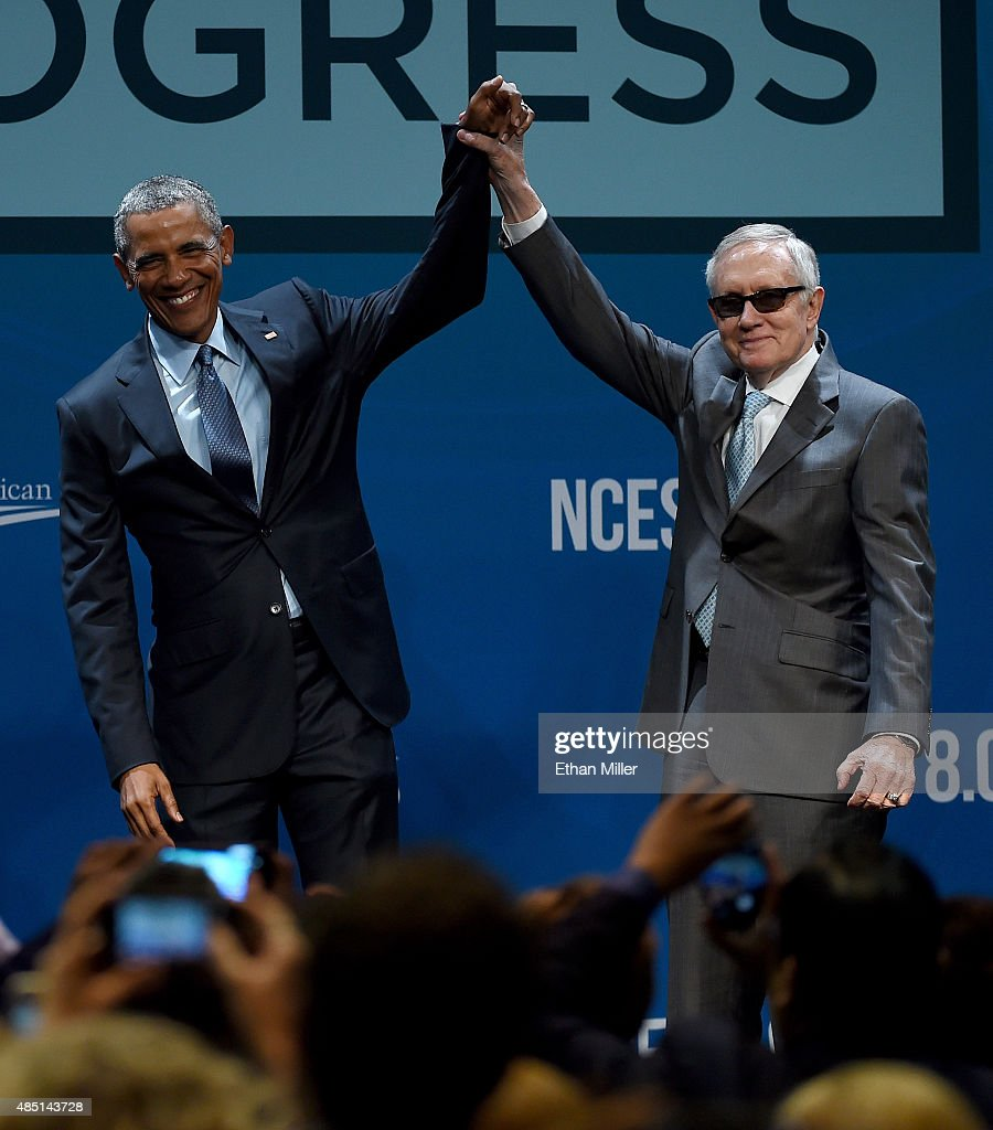S President Barack Obama and US Senate Minority Leader Harry Reid gesture after Obama delivered the keynote address at the National Clean Energy...