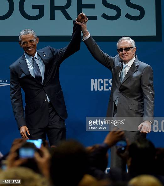 S President Barack Obama and US Senate Minority Leader Harry Reid gesture after Obama delivered the keynote address at the National Clean Energy...