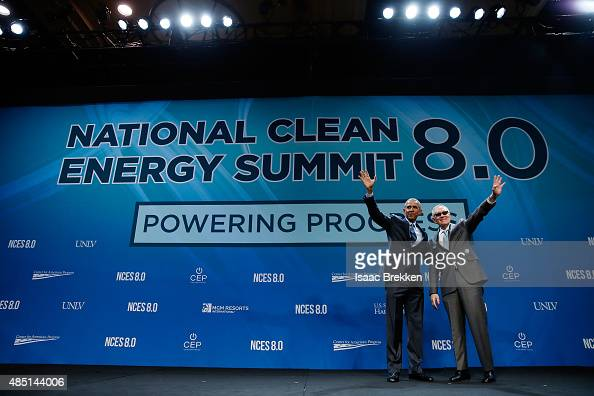 President Barack Obama and US Senate Minority Leader Harry Reid wave following a keynote address during the National Clean Energy Summit 80 at the...