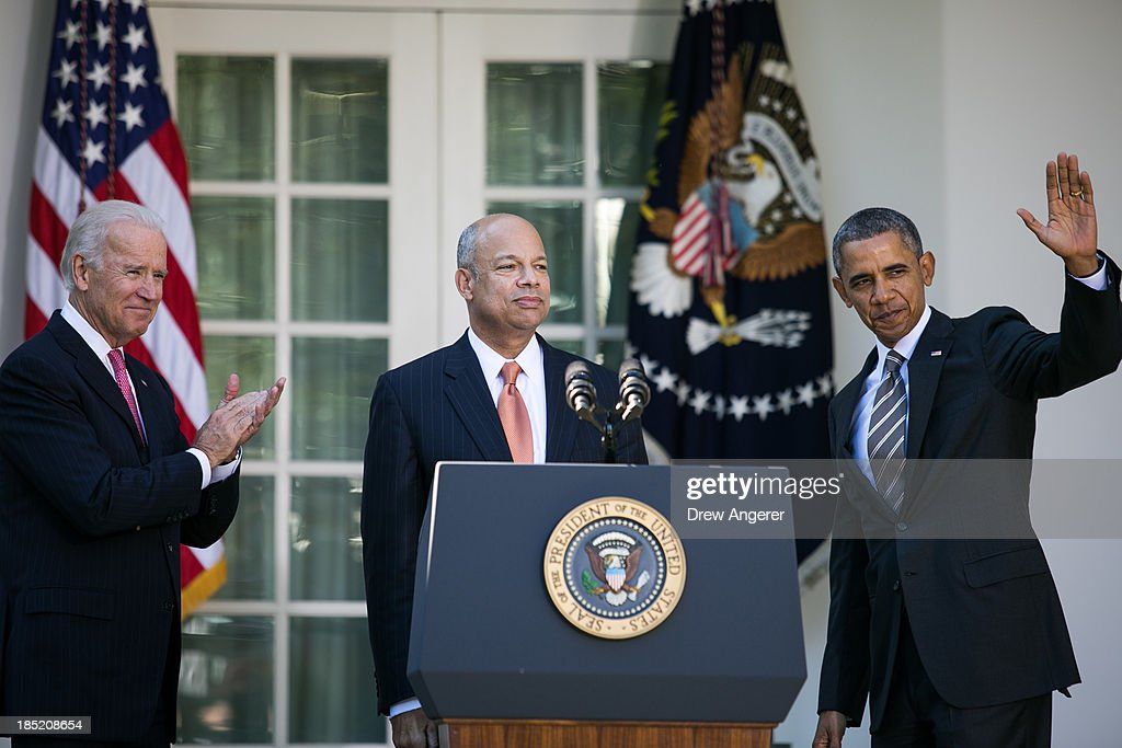 U.S. President <a gi-track='captionPersonalityLinkClicked' href=/galleries/search?phrase=Barack+Obama&family=editorial&specificpeople=203260 ng-click='$event.stopPropagation()'>Barack Obama</a>, (R) and U.S. Vice President Joe Biden, (L) applaud and wave as Jeh Johnson(C) the president's nominee to be the next Secretary of the Department of Homeland Security, finishes his remarks in the Rose Garden of the White House, October 18, 2013 in Washington, DC. The Department of Homeland Security has been without a Senate-confirmed leader for six weeks.