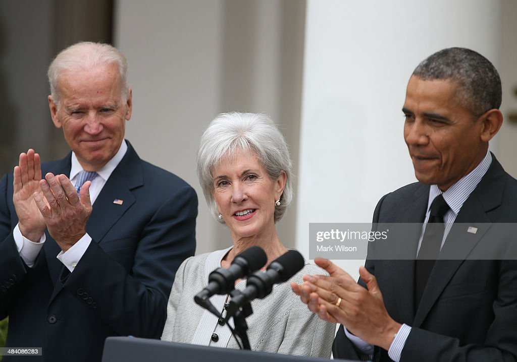 U.S. President Barack Obama (R) and U.S. Vice President Joe Biden (L) applaud outgoing Health and Human Services Secretary Kathleen Sebelius (C) during an event in the Rose Garden at the White House, on April 11, 2014 in Washington, DC. President Obama announced his nomination of Director of the White House Office of Management and Budget Sylvia Mathews Burwell to succeed Sebelius as Secretary.