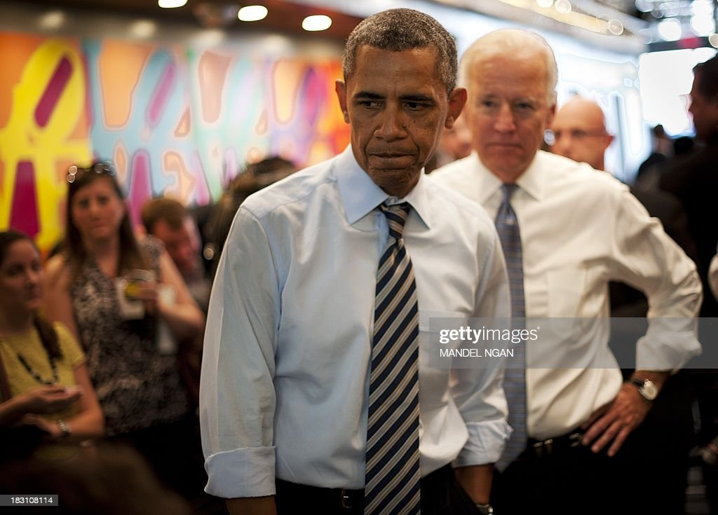 US President Barack Obama and US Vice President Joe Biden (R) arrive to order lunch to go at Taylor Gourmet Deli on Pennsylvania Ave in Washington, DC on October 4, 2013. AFP PHOTO/Mandel NGAN