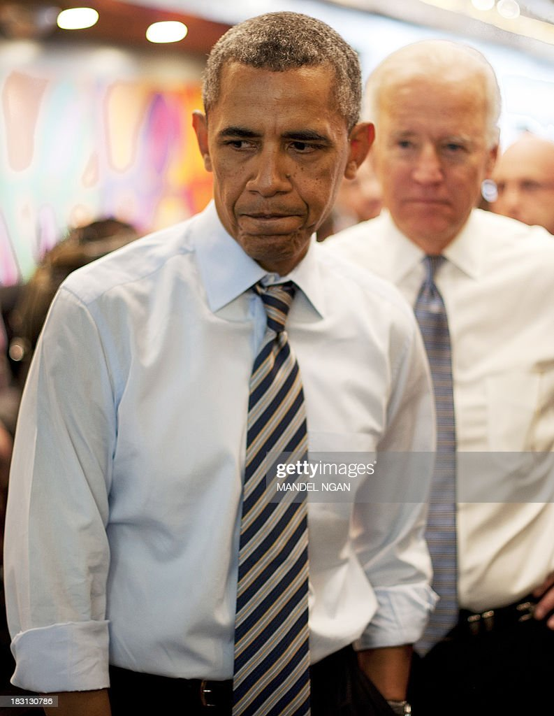 President Barack Obama and US Vice President Joe Biden (R) arrive to order lunch to go at Taylor Gourmet Deli on Pennsylvania Ave in Washington, DC on October 4, 2013. America's global standing among both allies and foes is being seriously undermined by the US government shutdown which forced President Barack Obama to cancel a key Asia tour, analysts said October 4, 2013. Some even warned that with no sign of a swift resolution, the political dysfunction in the corridors of the world's largest superpower poses a major threat to national security. In a rare foray into US politics, State Department deputy spokeswoman Marie Harf blasted what she called a 'damaging' shutdown that 'really negatively impacts our standing abroad.' Reading damning headlines about the US predicament from Mexican, Indian, Spanish and Taiwanese newspapers, she said: 'For a Congress that talks a lot about American exceptionalism, they're sending the exact opposite message all around the world right now.' Nations where America's constant drive to push values like democracy, free speech and transparent government is an anathema are likely viewing the self-imposed US paralysis with some glee. AFP PHOTO/Mandel NGAN