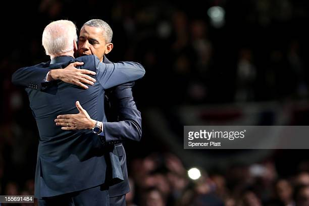S President Barack Obama and US Vice President Joe Biden embrace on stage after r his victory speech on election night at McCormick Place November 6...