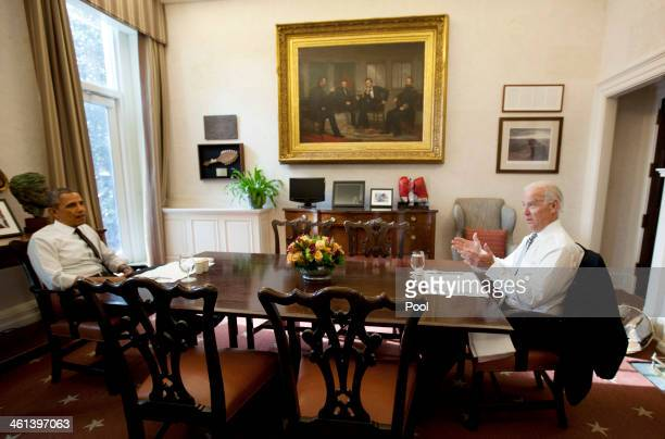 S President Barack Obama and US Vice President Joe Biden meet for lunch in the Private Dining Room of the White House January 8 2014 in Washington DC...
