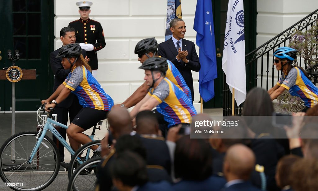 U.S. President <a gi-track='captionPersonalityLinkClicked' href=/galleries/search?phrase=Barack+Obama&family=editorial&specificpeople=203260 ng-click='$event.stopPropagation()'>Barack Obama</a> and Veterans Affairs Secretary <a gi-track='captionPersonalityLinkClicked' href=/galleries/search?phrase=Eric+Shinseki&family=editorial&specificpeople=2597806 ng-click='$event.stopPropagation()'>Eric Shinseki</a> welcome participants in the Wounded Warrior Project's Soldier Ride at the White House April 17, 2013 in Washington, DC. The Wounded Warrior Soldier Ride is an event designed to assist wounded U.S. veterans in using cycling to overcome physical, mental, or emotional wounds.