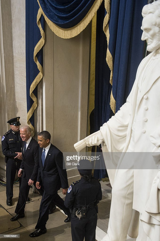 President Barack Obama and Vice President Joe Biden arrive in the Rotunda following the inauguration ceremony on the West Front of the Capitol on Monday, Jan. 21, 2013.