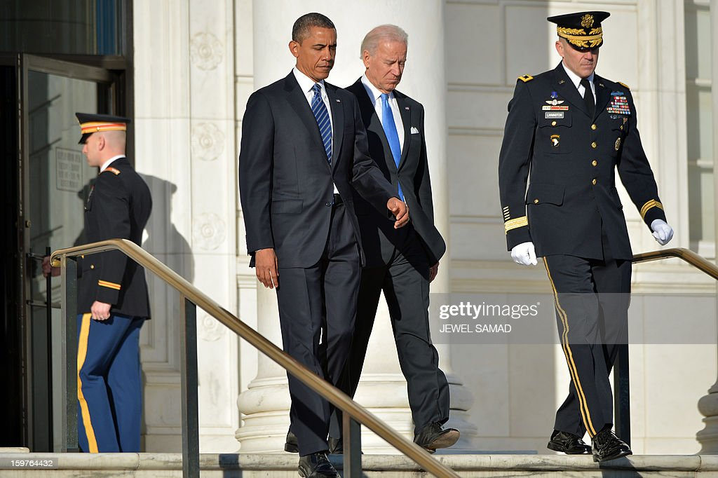 US President Barack Obama and Vice President Joe Biden arrive to lay a wreath at the Tomb of the Unknowns at Arlington National Cemetery in Arlington, Virginia, on January 20, 2013. Obama will be officially sworn in for a second term in office later in the day. AFP PHOTO/Jewel Samad