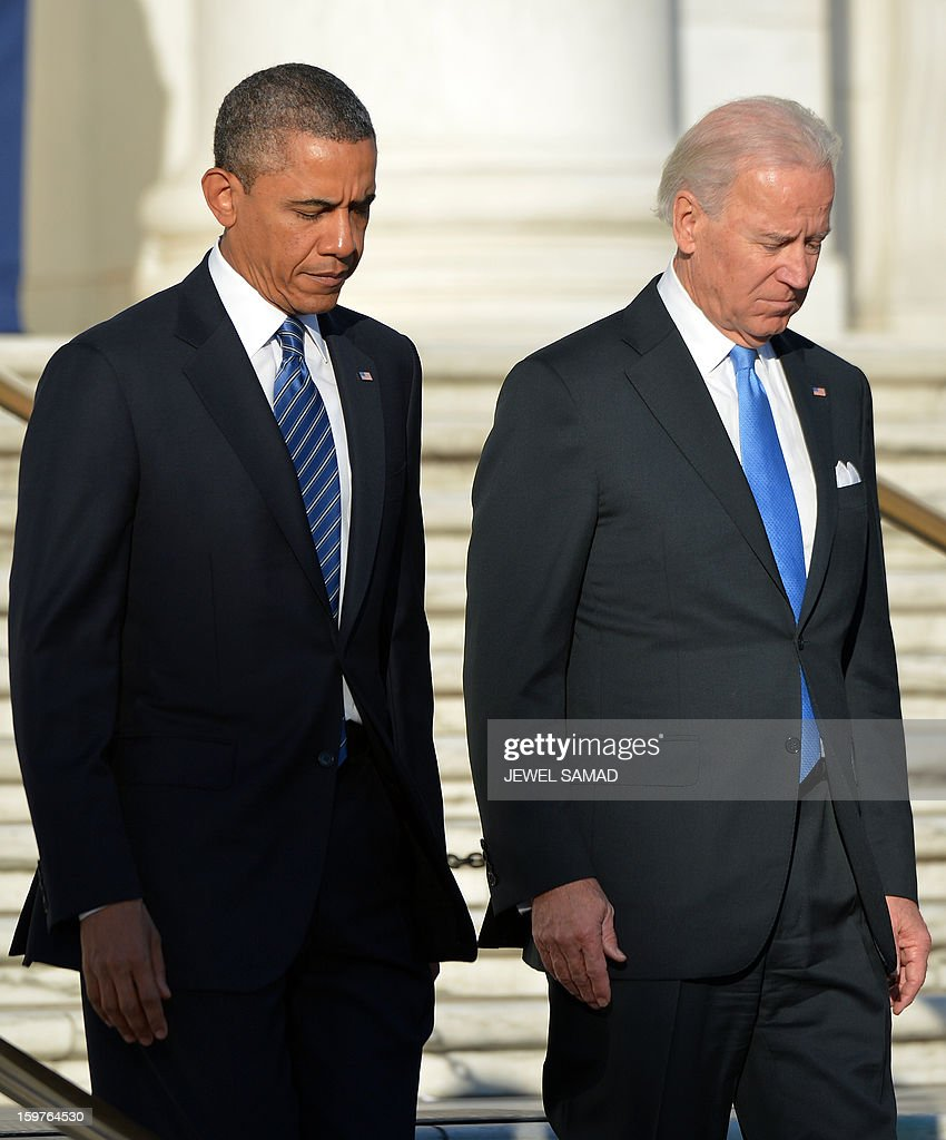 US President Barack Obama and Vice President Joe Biden arrive to lay a wreath at the Tomb of the Unknowns at Arlington National Cemetery in Arlington, Virginia, on January 20, 2013. Obama and Biden will be officially sworn in for a second term in office later in the day. AFP PHOTO/Jewel Samad