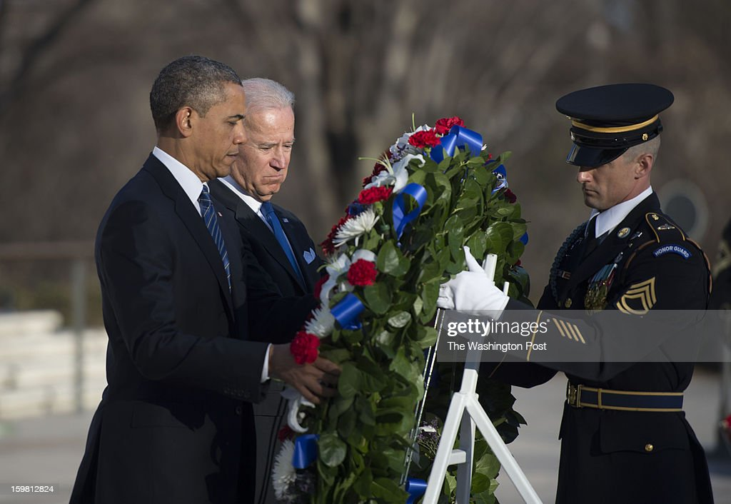 President Barack Obama and Vice President Joe Biden attend a wreath laying at the Tomb of the Unknowns at Arlington National Cemetery in Arlington, Virginia on January 20, 2013.