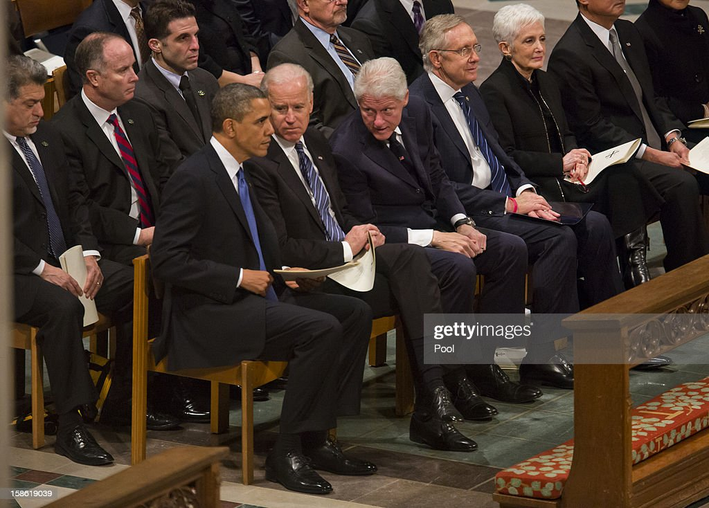 U.S. President Barack Obama (L) and Vice President Joe Biden (C) attend the funeral service for the late Sen. Daniel Inouye (D-HI) at the Washington National Cathedral December 21, 2012 in Washington, DC. Inouye was a World War II veteran and then later the second-longest serving senator in history.