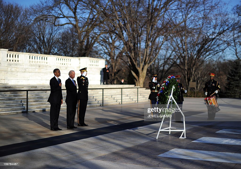 US President Barack Obama and Vice President Joe Biden lay a wreath at the Tomb of the Unknowns at Arlington National Cemetery in Arlington, Virginia, on January 20, 2013. Obama and Biden will be officially sworn in for a second term in office later in the day. AFP PHOTO/Jewel Samad