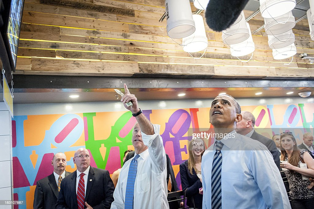 U.S. President <a gi-track='captionPersonalityLinkClicked' href=/galleries/search?phrase=Barack+Obama&family=editorial&specificpeople=203260 ng-click='$event.stopPropagation()'>Barack Obama</a> (R) and Vice President Joe Biden look over the menu at Taylor Gourmet on Pennsylvania Avenue after walking from the White House for a take-out lunch October 4, 2013 in Washington, DC. Democrats and Republicans are still at a stalemate on funding for the federal government as the shutdown goes into the fourth day. The deli, like many other eateries in Washington, is currently offering a discount for furloughed federal workers.