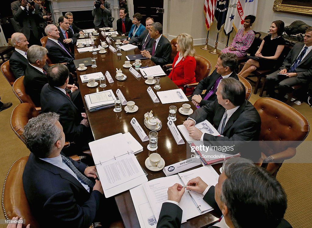 President Barack Obama and Vice President Joe Biden (L) meet with U.S. Governors Association Executive Committee members Delaware Gov. Jack Markell, Minnesota Gov. Mark Dayton, Arkansas Gov. Mike Beebe, Utah Gov. Gary Herbert, Wisconsin Gov. Scott Walker and Oklahoma Gov. Mary Fallin in the Roosevelt Room at the White House December 4, 2012 in Washington, DC. Obama Administration members that attended the meeting included Valerie Jarrett, Treasury Secretary Timotny Geithner, Vice Presidential Chief of Staff Bruce Reed; National Economic Council Director Gene Sperling; Council of Economic Advisers Chairman Alan Kreuger and Office of Managment and Budget acting director Jeffery Zients. The governors met with the president to discuss the 'fiscal cliff' and will head to Capitol Hill to meet with Speaker of the House John Boehner (R-OH) later in the day.