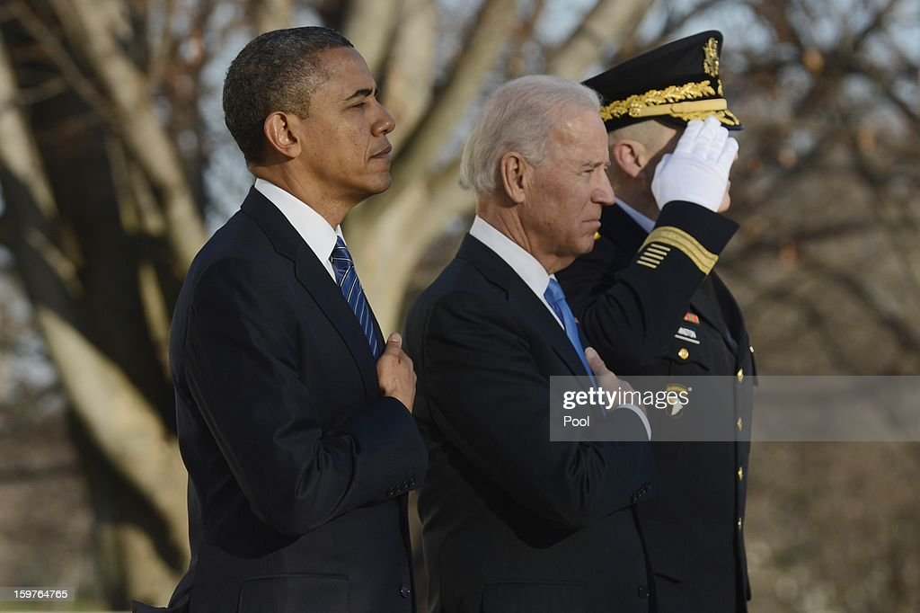 President Barack Obama and Vice President Joe Biden participate in a wreath-laying ceremony at the Tomb of the Unknown Soldier January 20, 2013 in Arlington National Cemetery, Arlington, Virginia. Both Obama and Biden will be sworn in today for a second term in office.