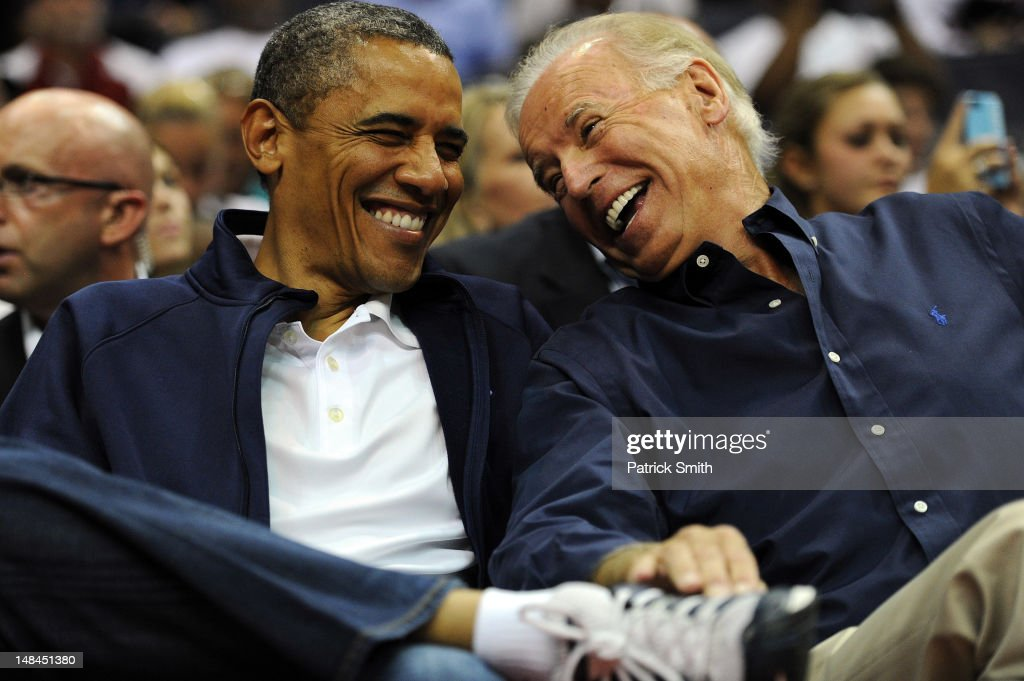 U.S. President <a gi-track='captionPersonalityLinkClicked' href=/galleries/search?phrase=Barack+Obama&family=editorial&specificpeople=203260 ng-click='$event.stopPropagation()'>Barack Obama</a> and Vice President Joe Biden share a laugh as the US Senior Men's National Team and Brazil play during a pre-Olympic exhibition basketball game at the Verizon Center on July 16, 2012 in Washington, DC.