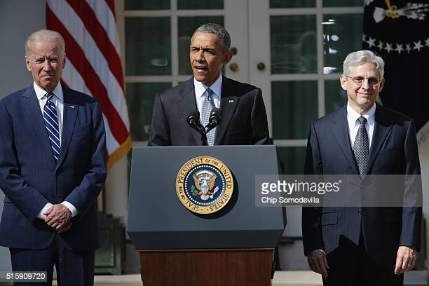 S President Barack Obama and Vice President Joe Biden stands with Judge Merrick B Garland while nominating him to the US Supreme Court in the Rose...