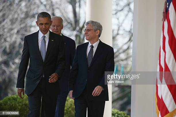 S President Barack Obama and Vice President Joe Biden walk out of the Oval Office with US Court of Appeals for the District of Columbia Circuit Chief...
