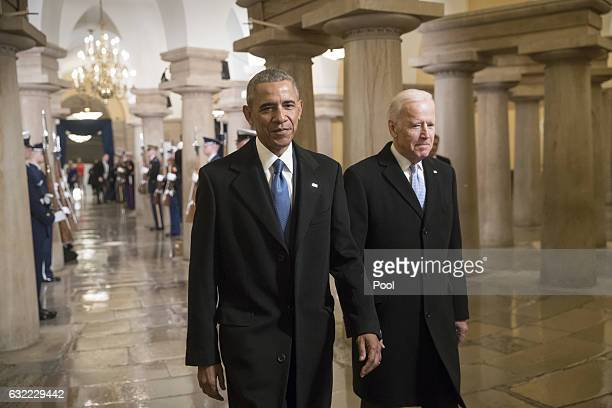 President Barack Obama and Vice President Joe Biden walk through the Crypt of the Capitol for Donald Trump's inauguration ceremony in Washington...