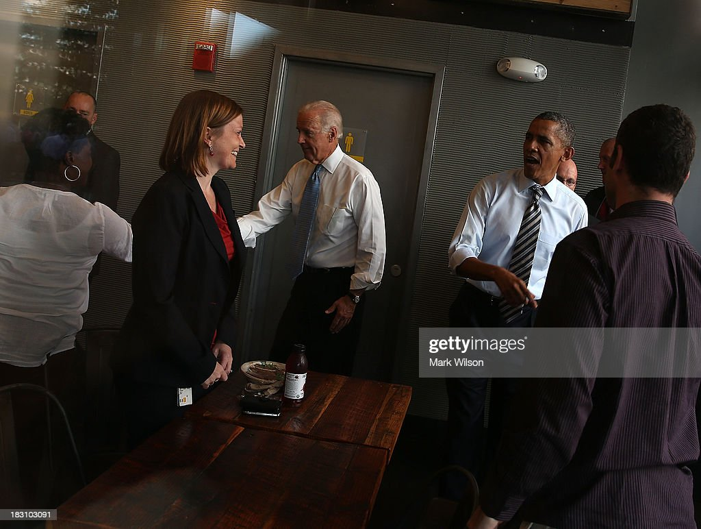 President Barack Obama and Vice President Joseph Biden greet people as they walk into the Taylor Gourmet Deli to pick up lunch, October 4, 2013 in Washington, DC. Democrats and Republicans are still at a stalemate on funding for the federal government as the shut down goes into the fourth day.