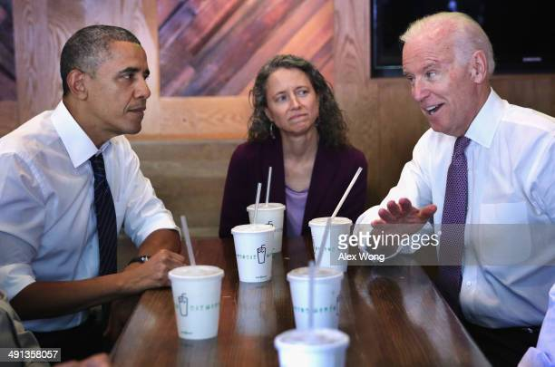 US President Barack Obama and Vice President Joseph Biden meet with local workers including Meredith Upchurch at the Dupont Circle location of...