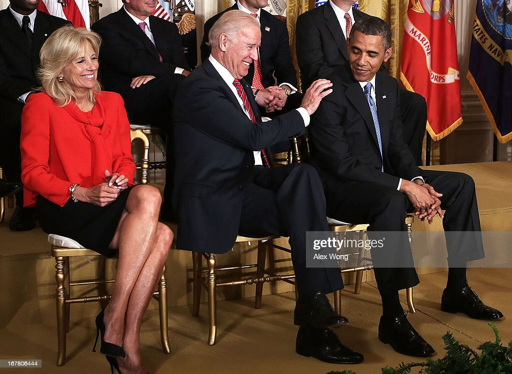 U.S. President <a gi-track='captionPersonalityLinkClicked' href=/galleries/search?phrase=Barack+Obama&family=editorial&specificpeople=203260 ng-click='$event.stopPropagation()'>Barack Obama</a> (R) and Vice President <a gi-track='captionPersonalityLinkClicked' href=/galleries/search?phrase=Joseph+Biden&family=editorial&specificpeople=206897 ng-click='$event.stopPropagation()'>Joseph Biden</a> (2nd L) share a moment as Biden's wife <a gi-track='captionPersonalityLinkClicked' href=/galleries/search?phrase=Jill+Biden&family=editorial&specificpeople=997040 ng-click='$event.stopPropagation()'>Jill Biden</a> (L) looks on during a veterans employment event in the East Room April 30, 2013 at the White House in Washington, DC. Michelle Obama and <a gi-track='captionPersonalityLinkClicked' href=/galleries/search?phrase=Jill+Biden&family=editorial&specificpeople=997040 ng-click='$event.stopPropagation()'>Jill Biden</a> encousrged the private sector to step up the hiring of veterans.