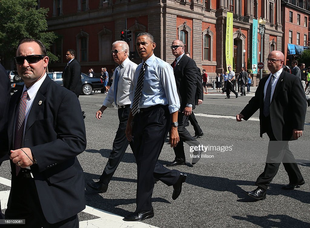 President Barack Obama and Vice President Joseph Biden walk down Pennsylvania Ave. to pick up lunch at the Taylor Gourmet Deli, October 4, 2013 in Washington, DC. Democrats and Republicans are still at a stalemate on funding for the federal government as the shut down goes into the fourth day.