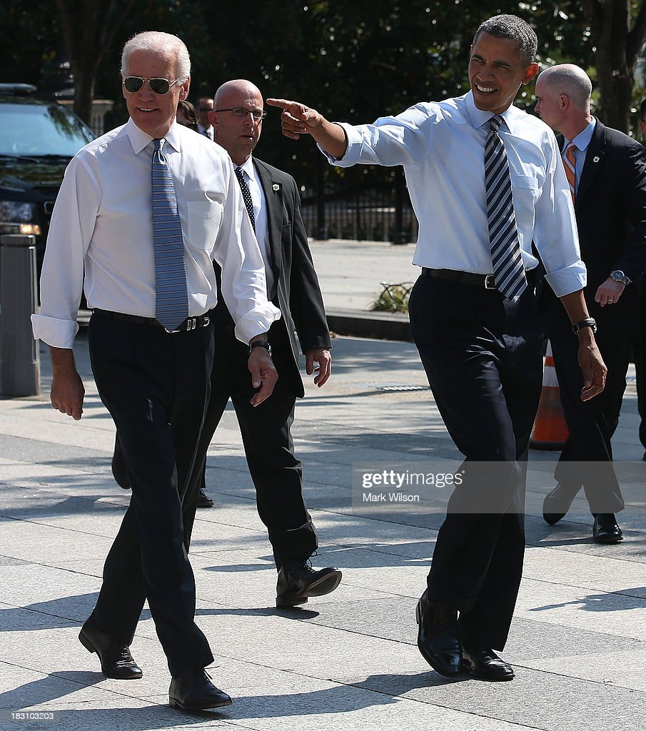 President <a gi-track='captionPersonalityLinkClicked' href=/galleries/search?phrase=Barack+Obama&family=editorial&specificpeople=203260 ng-click='$event.stopPropagation()'>Barack Obama</a> (R) and Vice President Joseph Biden walk down Pennsylvania Ave. to pick up lunch at the Taylor Gourmet Deli, October 4, 2013 in Washington, DC. Democrats and Republicans are still at a stalemate on funding for the federal government as the shut down goes into the fourth day.