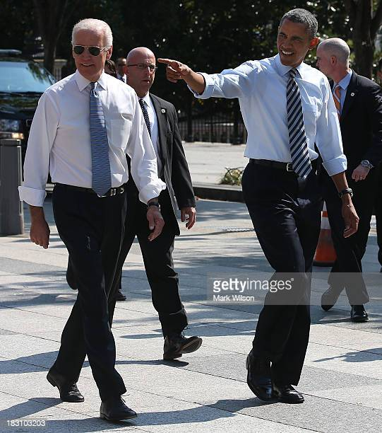 President Barack Obama and Vice President Joseph Biden walk down Pennsylvania Ave to pick up lunch at the Taylor Gourmet Deli October 4 2013 in...