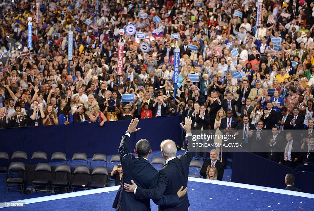 US President Barack Obama and VicePresident Joe Biden acknowledge the audience at the conclusion of Obama and Biden's acceptance of the Democratic...