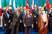 S President Barack Obama and world leaders pose for the annual G20 family photograph on November 15 2014 in Brisbane Australia World leaders have...