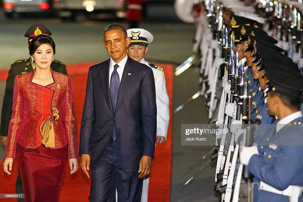 US President Barack Obama and Yingluck Shinawatra, Prime Minister of Thailand, review Thai troops during a welcoming ceremony for President Obama , outside Government House on November 18, 2012 in Bangkok. Obama will become the first serving US President to visit Myanmar during the four-day tour of Southeast Asia that will also include visits to Thailand and Cambodia.