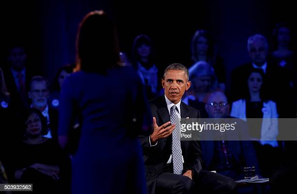 US President Barack Obama answers a question at town hall at George Mason University on January 7 2016 in Fairfax Virginia The president this week...