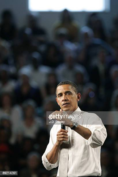 S President Barack Obama answers a question during a town hall meeting July 22 at Shaker Heights high school in Shaker Heights Ohio Obama was in Ohio...