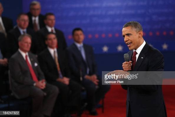 S President Barack Obama answers a question during a town hall style debate at Hofstra University October 16 2012 in Hempstead New York During the...