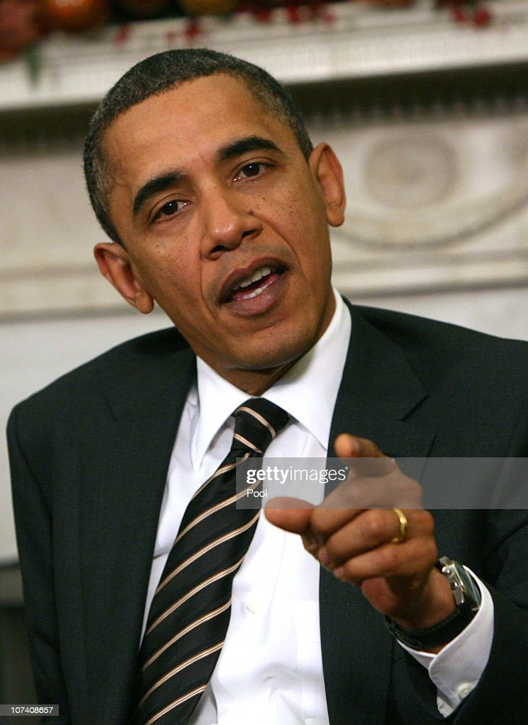 U.S. President <a gi-track='captionPersonalityLinkClicked' href=/galleries/search?phrase=Barack+Obama&family=editorial&specificpeople=203260 ng-click='$event.stopPropagation()'>Barack Obama</a> answers a reporter's question about his tax compromise as he meets with Polish President Bronislaw Komorowski in the Oval Office on December 8, 2010 in Washington, DC. Obama and Komorowski were to meet for two bilateral meetings at the White House today.