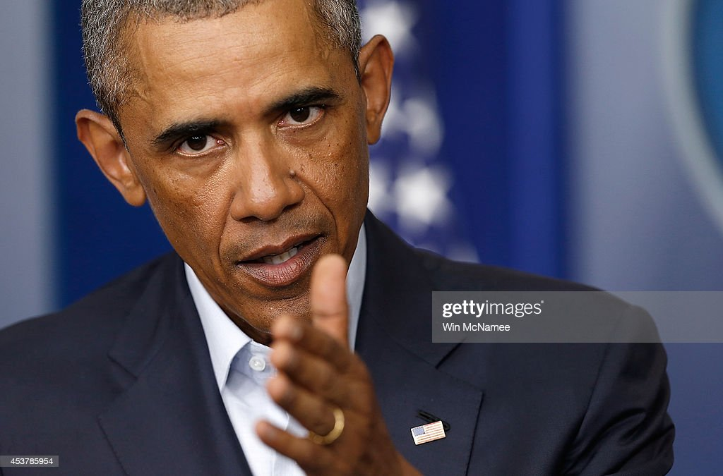 U.S. President <a gi-track='captionPersonalityLinkClicked' href=/galleries/search?phrase=Barack+Obama&family=editorial&specificpeople=203260 ng-click='$event.stopPropagation()'>Barack Obama</a> answers questions at a press conference after delivering a statement in the Brady Press Briefing Room of the White House on August 18, 2014 in Washington, DC. Obama returned early from his vacation in Martha's Vineyard to hold meetings with his national security team and also with U.S. Attorney General Eric Holder in regards to the situation in Iraq and the continuing violence in Ferguson, Missouri.