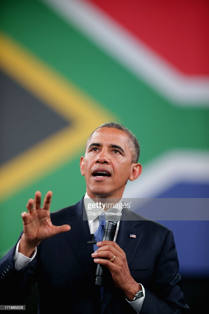 U.S. President <a gi-track='captionPersonalityLinkClicked' href=/galleries/search?phrase=Barack+Obama&family=editorial&specificpeople=203260 ng-click='$event.stopPropagation()'>Barack Obama</a> answers questions from the audience and from people in Nigeria, Uganda and Kenya via live video link during a 'town hall' meeting with the young African leaders at the University of Johannesburg in Soweto June 29, 2013 in Johannesburg, South Africa. South Africa is the second leg of Obama's three-country tour of the African continent, which includes Senegal and Tanzania.