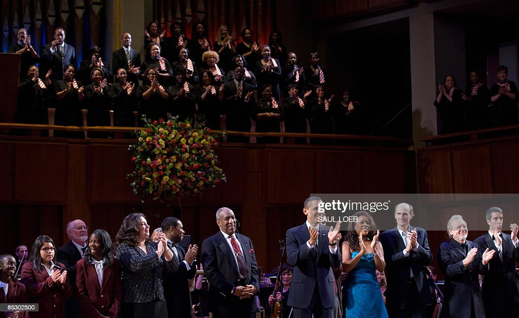 US President <a gi-track='captionPersonalityLinkClicked' href=/galleries/search?phrase=Barack+Obama&family=editorial&specificpeople=203260 ng-click='$event.stopPropagation()'>Barack Obama</a> applauds after leading the singing of Happy Birthday to Massachusetts Senator Ted Kennedy during a musical birthday salute to Kennedy at the Kennedy Center in Washington, DC, March 8, 2009. AFP PHOTO / Saul LOEB