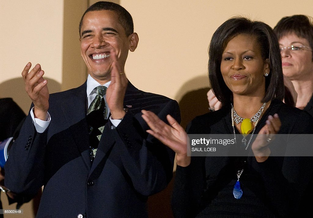 US President <a gi-track='captionPersonalityLinkClicked' href=/galleries/search?phrase=Barack+Obama&family=editorial&specificpeople=203260 ng-click='$event.stopPropagation()'>Barack Obama</a> applauds alongside First Lady <a gi-track='captionPersonalityLinkClicked' href=/galleries/search?phrase=Michelle+Obama&family=editorial&specificpeople=2528864 ng-click='$event.stopPropagation()'>Michelle Obama</a> during a musical birthday salute to Massachusetts Senator Ted Kennedy at the Kennedy Center in Washington, DC, March 8, 2009. AFP PHOTO / Saul LOEB