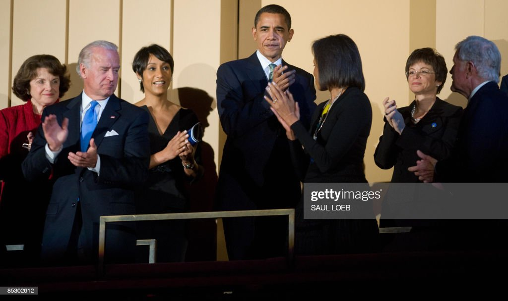 US President <a gi-track='captionPersonalityLinkClicked' href=/galleries/search?phrase=Barack+Obama&family=editorial&specificpeople=203260 ng-click='$event.stopPropagation()'>Barack Obama</a> (C) applauds alongside US Vice President Joe Biden (2nd L), First Lady <a gi-track='captionPersonalityLinkClicked' href=/galleries/search?phrase=Michelle+Obama&family=editorial&specificpeople=2528864 ng-click='$event.stopPropagation()'>Michelle Obama</a> (3rd R) and Massachusetts Senator Ted Kennedy (R) during a musical birthday salute to Kennedy at the Kennedy Center in Washington, DC, March 8, 2009. AFP PHOTO / Saul LOEB