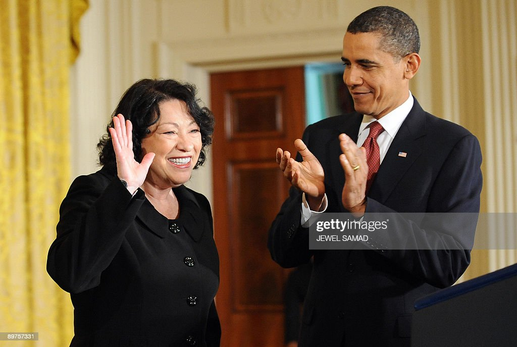 US President Barack Obama applauds as Justice Sonia Sotomayor waves at the crowd as they arrive for a reception in the honor of Justice Sotomayor in the East Room at the White House on August 12, 2009 in Washington,DC. Sotomayor was sworn in on August 8 in a public ceremony as a US Supreme Court justice, becoming the first Hispanic justice on the nation's highest bench. AFP PHOTO/Jewel SAMAD