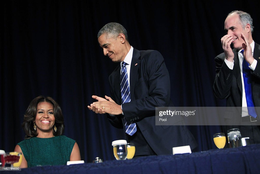 U.S. President <a gi-track='captionPersonalityLinkClicked' href=/galleries/search?phrase=Barack+Obama&family=editorial&specificpeople=203260 ng-click='$event.stopPropagation()'>Barack Obama</a> applauds the first lady <a gi-track='captionPersonalityLinkClicked' href=/galleries/search?phrase=Michelle+Obama&family=editorial&specificpeople=2528864 ng-click='$event.stopPropagation()'>Michelle Obama</a> during the National Prayer Breakfast as U.S. Sen. Robert Casey (D-PA) looks on February 5, 2015 in Washington, DC, Obama reportedly spoke about groups, like ISIS,, distorting religion and calling the Islamic terror group a 'death cult.'