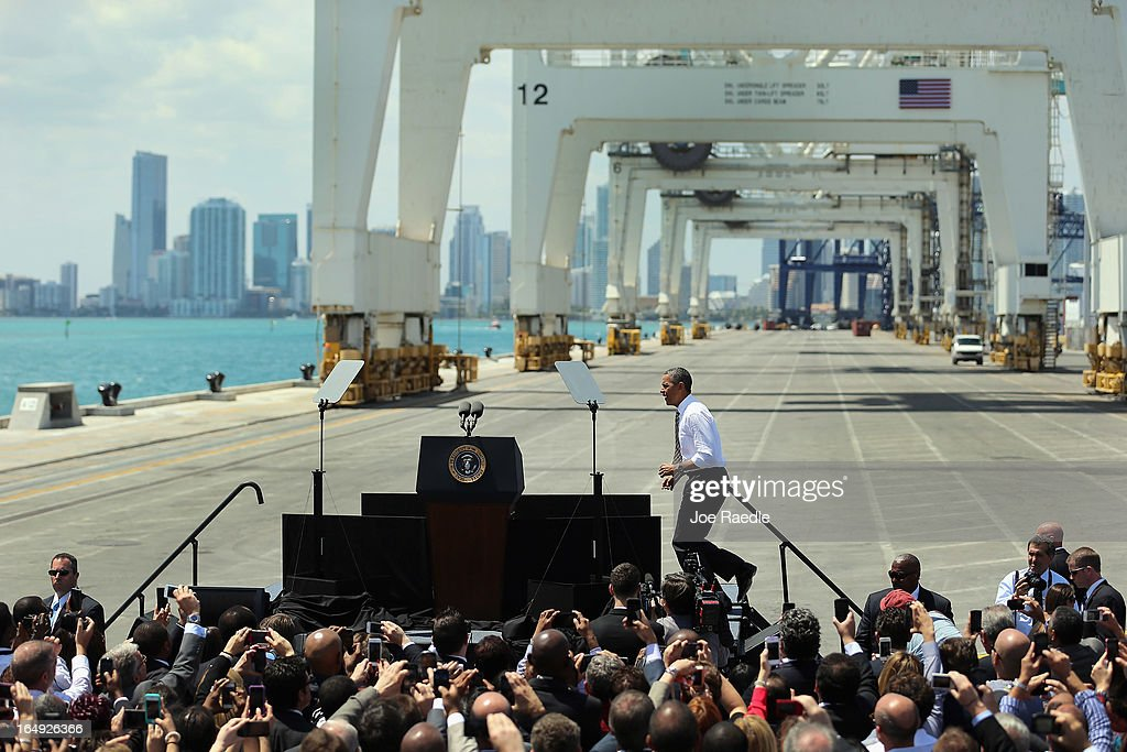 President Barack Obama approaches the podium during an event at PortMiami on March 29, 2013 in Miami, Florida. The president spoke about road and bridge construction during the event at the port in Miami, where he also toured a new tunnel project.