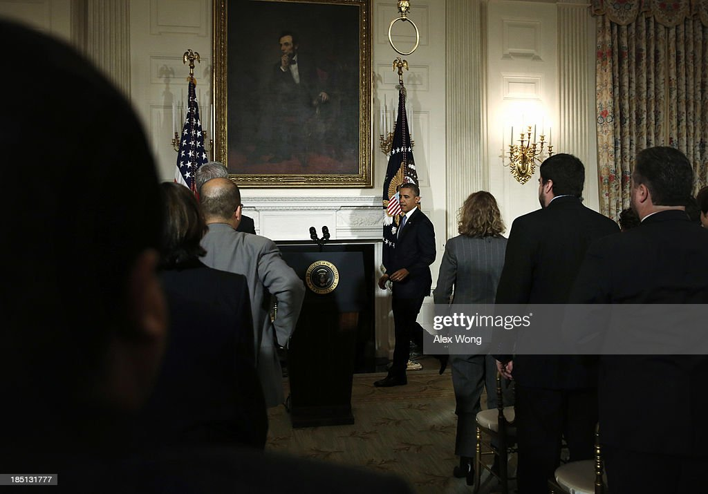 U.S. President <a gi-track='captionPersonalityLinkClicked' href=/galleries/search?phrase=Barack+Obama&family=editorial&specificpeople=203260 ng-click='$event.stopPropagation()'>Barack Obama</a> approaches the podium to make a statement at the State Dining Room of the White House October 17, 2013 in Washington, DC. Obama said the American people are completely fed up with Washington and called on cooperation to work things out.