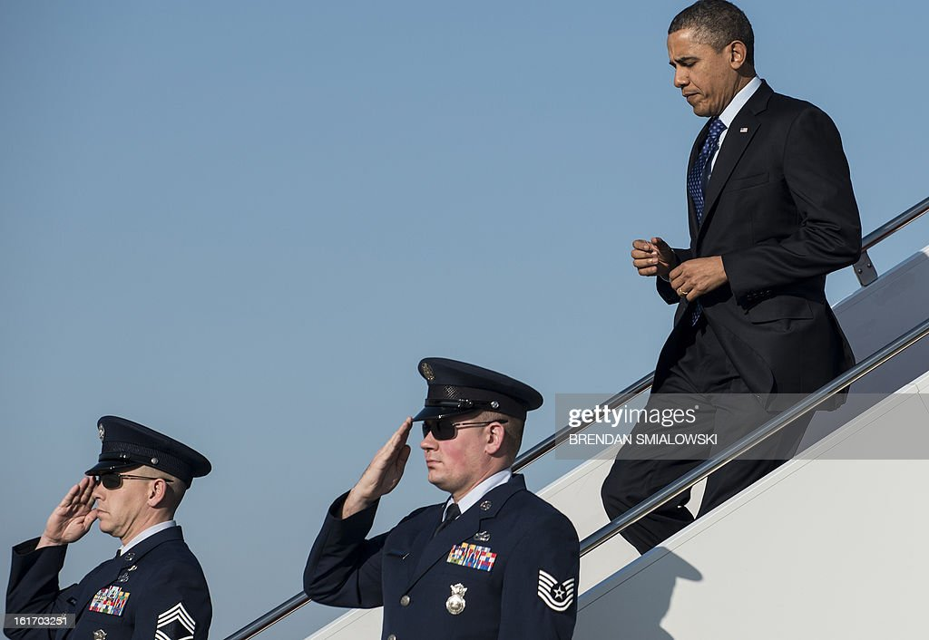 US President Barack Obama arrives at Andrews Air Force Base February 14, 2013 in Maryland. Obama traveled to Georgia to promote economic and educational initiatives he spoke about in this week's State of the Union. AFP PHOTO/Brendan SMIALOWSKI