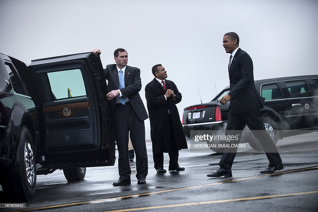 US President Barack Obama arrives at Asheville Regional Airport on February 13, 2013 in Asheville, North Carolina. Obama is traveling to Asheville to visit the Linamar factory to push his economic growth plan he spoke about in the State of the Union. AFP PHOTO/Brendan SMIALOWSKI
